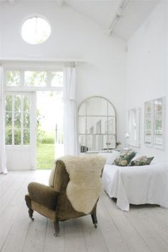 Don't have the time, energy or funds to reuphoster a chair?  Throw a sheepskin rug over it!!!
