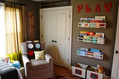 A cozy spot to read, handmade shelves for books and wooden boxes full of toys waiting to be played with!