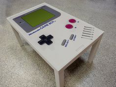 NES - Nintendo Gameboy Coffee Table.  One product has been added to the fun. With the NES coffee table will be on hand all control.   Dimension: 90