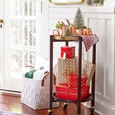 Here's how to start the party: Make an entryway area where guests can exchange hostess gifts for a top-shelf Moscow Mule. Cheers to making the most out of your bar cart.