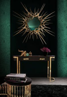 KOI - The KOI scales from the sides of the modern console table shine and reflect the sun on its brass surface. CAY - This modern console table flows