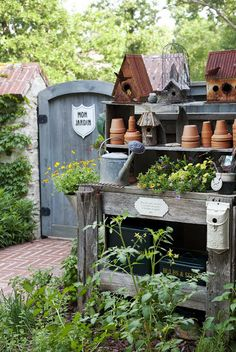 Wooden Potting Bench nestled in an herb and vegetable garden