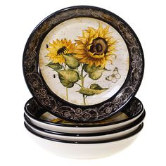 Refresh your table setting with the beauty and craftsmanship of this hand-painted French Sunflowers soup/pasta bowl set. Crafted of durable, lead-free ceramic, this pleasing set features a vintage look with a sunflower motif.