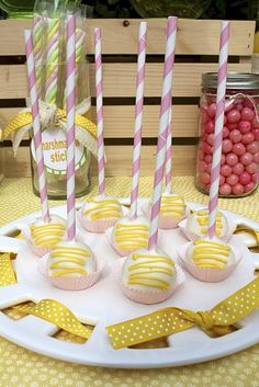 cake pops - in lemonade colors, and with paper straw handles !! ♥