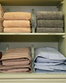 Folding Towels and Linens- great way to keep the linen closet under control