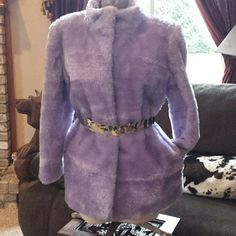 """Amazing lavender jacket Absolutely beautiful lavender faux fur jacket. Simply ahhhmazing. 2 hook n eye closures. 2 pockets  gorgeous jacket. One stunning stand out in the crowd jacket. Small staining on the lining i believe to be eazy to remove, see last picture  measurements  Shoulder to shoulder just over 17"""" Sleeve length 23"""" total length 29"""" *belt not included * Jackets & Coats"""