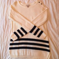 Cream and Navy Striped LOFT Sweater This sweater is cream with navy stripes around the bottom and the sleeves with buttons on the shoulder. It's in perfect condition- only been worn once LOFT Sweaters Crew & Scoop Necks