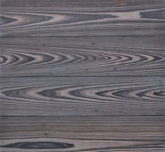 Shou Sugi Ban is stained gray for a clean and contemporary look. For more, visit www.matchstickwoods.com.