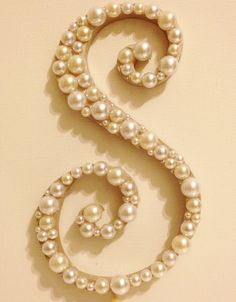 Pearl Monogram Cake Topper - White or Ivory Pearls. $26.50, via Etsy.   ...for $26 you could probably DIY this thing for $6.