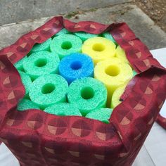 7 pool noodle DIY idea. Foot stool, but would make a great window seat wall cushion