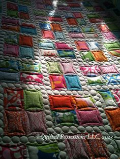 Fast, easy and fun.  Great practice for circles.  Quilted by Stacey Stephens at Quilted Possessions LLC