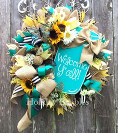 The colors, aqua with the sunflowers plus keep a little pink to go with the theme Deco Mesh Wreaths, Holiday Wreaths, Door Wreaths, Easter Wreaths, Wreath Crafts, Diy Wreath, Wreath Ideas, Swag Ideas, Welcome Wreath