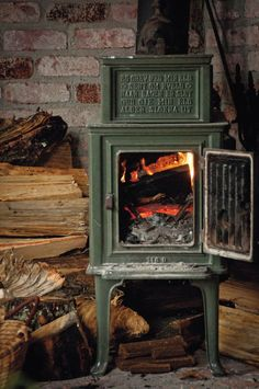 A wood-burning stove is one of the rustic touches in Gleeson's 1,000-square-foot cabin that houses the author's creative projects, including a sofa, left, reupholstered in fabric with an orange grove motif.