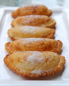 Empanadas de Vient: The combination of the gooey cheese and onions inside a crispy fried empanada and topped with sugar is delicious. These empanadas de viento are the perfect breakfast or afternoon snack with a hot cup of black coffee. Comida Latina, Cheese Fries, Fried Cheese, Cheese Empanadas Recipe, Bolivian Food, Bolivian Recipes, African Recipes, Great Recipes, Favorite Recipes