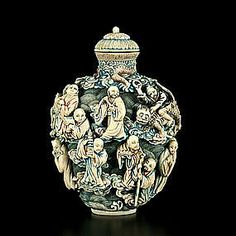 A large carved ivory snuff bottle