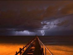 Lightning strikes in the distance off the coast of Israel. - Baz Ratner/Reuters