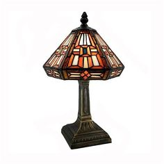 Price: $55.44 Warehouse of Tiffany 726+MB126 TiffanyStyle Table Lamp, Bronze - Handcrafted using the same techniques that were developed by Louis Comfort Tiffany in the early 1900s.     This beautiful Tiffany-style piece contains hand-cut pieces of stained glass, each wrapped in fine copper foil  Warm amber and creamy ivory tones are features in this beautiful Tiffany-style lamp  The bronze finish and structured base add warmth and refinement to this elegant table lamp