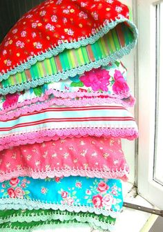 ideas (not a pattern).  Cheerful pillowcases using different fabrics on both sides. Finish with scallop crochet edge...I love the color and pattern selections.