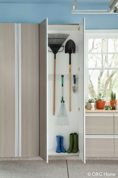 Keep your seasonal garden tools at hand, but far from tripping over them with a tool hanger in your custom garage cabinets. Get your dream garage from NOLA Closets! We're so much more than closets. Metal Garage Cabinets, Armoire Garage, Garage Wall Shelving, Garage Shed, Wood Cabinets, Dream Garage, Garage Organization Systems, Garage Storage Solutions, Home Organization