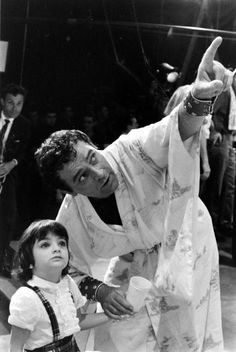 Not published in LIFE. Richard Burton with Elizabeth Taylor's daughter, Liza, on the set of Cleopatra, Rome, 1962.