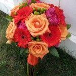 Orange rose handtied wedding flower bouquet with gerbera and berries