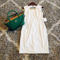 NWT Calvin Klein Gorgeous White Sheath Dress This is a New With Tag Calvin Klein sleeveless sheath dress in white with a gold colored chain accent at the neckline. Size 4. Perfect for spring or summer!!  Bag picture will also be listed today. Check my closet!!! Calvin Klein Dresses
