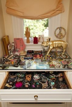 see through vanity table with loads of jewelry space. jewel me up. and a sparkly golden pig? too perfect for sam