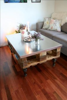 sheet metal top pallet coffee table- you could do this on the top of any workbench, table, old dresser, etc.