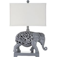 Cast a chic glow over your nightstand or favorite reading nook with this exotic table lamp, showcasing an elephant-shaped base and openwork details.