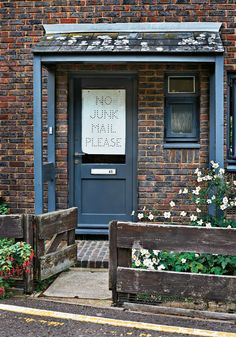 The entrance to artist Francis Upritchard and furniture designer Martino Gamper's home in London's Hackney district; Alex Rich and Jürg Lehni made the window sign