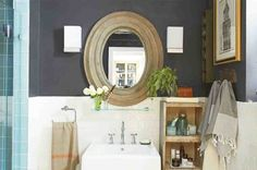 A floating glass shelf below the mirror adds storage seamlessly. Next to the sink, a rustic wood unit houses skincare and towels. Turkish towels, $10 each, westelm.com. Assorted bath products, fresh.com.