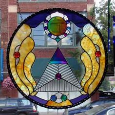 stained glass panel made with dichroic glass bevels and jewels that I make and sell as well as offer a video lesson plan on making dichroic glass components. contact me at askdichroglassman@yahoo.com