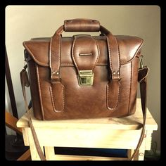 """Vintage Camera Bag Vintage Camera Bag. Exterior is in good shape, interior has staining and smells """"old"""". Would be great to use as a make up bag or even a unique office bag. Had a rigid structure, hand straps and long shoulder strap, footed bottom. 10"""" tall, 14"""" wide, 7"""" deep. You will want to change out the lining. 1111/359/031516 Vintage Bags Travel Bags"""