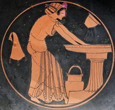 A woman at a washbasin, accompanied by a water bucket, a skyphos (two-handled wine-cup), and a wineskin, and encircled by a kalos-inscription. Tondo of an Attic red-figure kylix, attributed to the painter Douris and the Euphronios Potter; ca. 500...