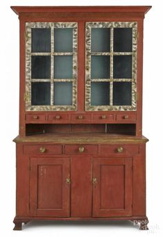 Winning bid:$3,800  Pennsylvania painted pine Dutch cupboard, ca. 1800, in two parts, the upper section having smoke decorated doors, over a bank of spice drawers, the base with three drawers over sunken panel doors, all resting on ogee feet, 85'' h., 47'' w. - Price Estimate: $3000 - $5000