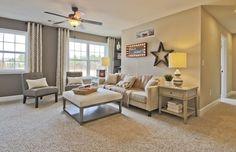 Living Room with Medium Beige Frieze (Twisted) Carpet, flush light, Ceiling fan, High ceiling, Carpet