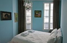 Pretty blue walls with dark green curtains