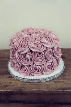 Single tiered wedding cake covered in lilac buttercream roses: