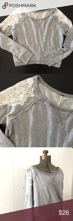 "Free People Lace Shoulder Pullover Sweatshirt // M Cute Free People sweatshirt. Heather gray with white lace at shoulders. Very good condition. 100% cotton. Size medium. 21"" shoulder to bottom hem. 22"" underarm to underarm. Free People Tops Sweatshirts & Hoodies"