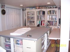 Sewing/quilting room with a huge ironing table and loads of storage.
