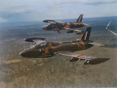 Here we have quite a unique photo of two Impala MK II's near Mpacha in December 1979. The aircraft nearest to the camera has the three-tone camouflage scheme used on the first few Impala Mk II's that was imported directly from Italy, while the second aircraft shows the scheme adopted later. The scheme was eventually changed to a darker scheme.
