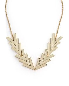 Neat necklace. Love the geometric shapes.