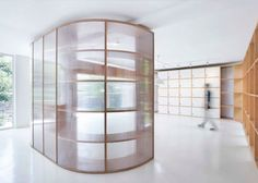 Semi-translucent polycarbonate panels and wooden shelving systems create partitions in this office renovation for a television station in Hangzhou, China, by Daipu Architects (+ slideshow). Hangzhou, Create Partition, Wood Partition, Office Interior Design, Interior Walls, Best Interior, Office Designs, Wood Interiors, Office Interiors