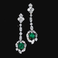 Pair of emerald and diamond pendent ear clips  Each designed as a sugarloaf emerald suspended from and framed by marquise-shaped and brilliant-cut diamonds.