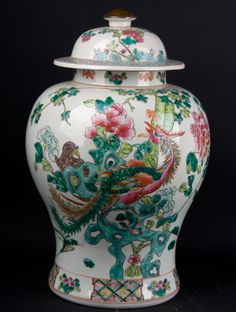 Description A bulbous Chinese 'famille rose' style jar & cover, Brightly decorated with a phoenix & a long tailed pheasant & other smaller birds amongst flowering peony & large pierced turquoise rocks, the cover rim with a broad ruyi head border, the foot with a reserved diaper border Date Chinese Republic www.collectorstrade.de