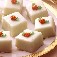 Petits Fours ~ These dainty icing-coated miniature cakes add a special touch to showers, open houses or teas. Try this easy Petits Fours recipe.