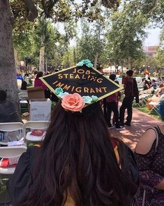 """Congrats to all the #ImmiGrads out there! Shout-out to @DefineAmerican and @UndocuMedia for their incredible #ImmiGrad initiative encouraging immigrant graduates to celebrate their achievements and share their stories with these brilliant #LatinxGradCaps. This post is via University of Southern California graduate, @eyeroll_qween: """"Just another job-stealing, hard-working, educated, proud, humble, chingona immigrant."""" • IMAGE DESCRIPTION: A photo of a woman with brown hair seated at an…"""