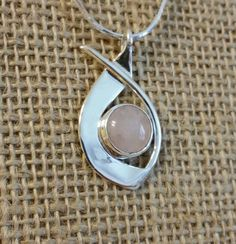 Another uniq jewelry pendant. Used a round pink quartz cabachon..... casual elegance!