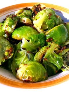 California Love – Maple and Mustard Brussels Sprouts: 2 c Brussels sprouts; cleaned and halved; 1 Tb whole grain mustard; 1 Tb maple syrup; 1 Tb butter; 1 Tb oil; S 4 slices crispy crumbled bacon (opt) - http://honestcooking.com