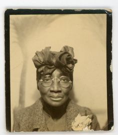 Stylish African American lady in fabulous head wrap vintage photo booth photo